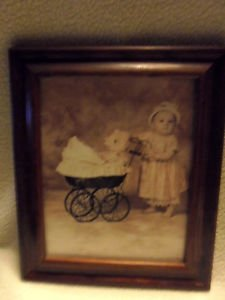 NICE WOOD FRAMED SEPIA PHOTO OF BABY GIRL PUSHING OLD STROLLER WITH BEAR-SO CUTE