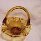 "VINTAGE AMBER NICE DESIGN HANDLED BASKET..FENTON?? APPROX  6.5"" WIDE"