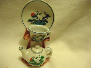 MINIATURE CUP/SAUCER/TEAPOT ON A STAND..ORIENTAL DESIGN WITH CRANES...