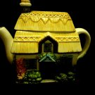 "CERAMIC HANDPAINTED HOUSE/COTTAGE TEAPOT..GREAT COLORING..8"" WIDE..6 3/4"" TALL"