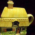 "NICE CERAMIC HANDPAINTED HOUSE/COTTAGE TEAPOT-..8"" WIDE..6 3/4"" TALL"