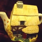 """BEAUTIFUL CERAMIC HANDPAINTED HOUSE/COTTAGE TEAPOT-..8"""" WIDE..6 3/4"""" TALL"""