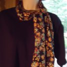 GIRLS/LADIES  LONG SCARF OF MIXED COLORS...COAT OF ARMS....NICE SIZE..SHINY