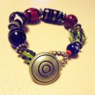 "BEAUTIFUL LARGE COLORFUL BEADED BRACELET-BUTTON CLOSURE...APPROX SIZE 7 1/2"" .."