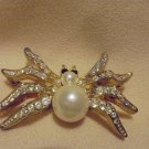 VINTAGE BROOCH/PIN SPIDER WITH FAUX PEARL BODY & RHINESTONE EYES..GOLD COLOR