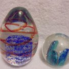 SET OF 2 GLASS PAPERWEIGHTS-OVAL & ROUND.... BRIGHT AND COLORFUL...NICE