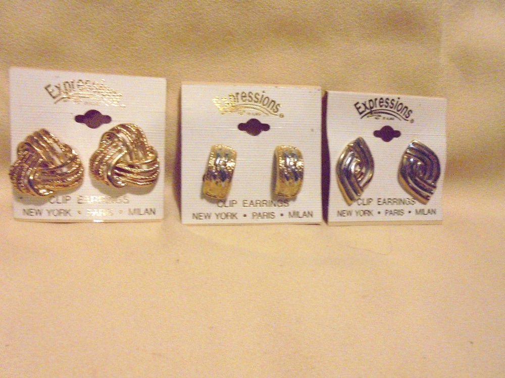 THREE PAIR OF CLIP ON EARRING.....NEW ON CARD...EXPRESSIONS BY ALMAR