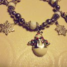 NICE LADIES/GIRLS SNOWMAN/SNOWFLAKE CHARM BRACELET....EIGHT CHARMS