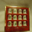 SET OF 12 BOXED HAND PAINTED THIMBLES WITH FLORAL ARRANGEMENTS....NICE