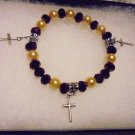 GOLD BEAD & PURPLE CRYSTAL STRETCH CHARM BRACELET WITH 3 CROSS CHARMS...