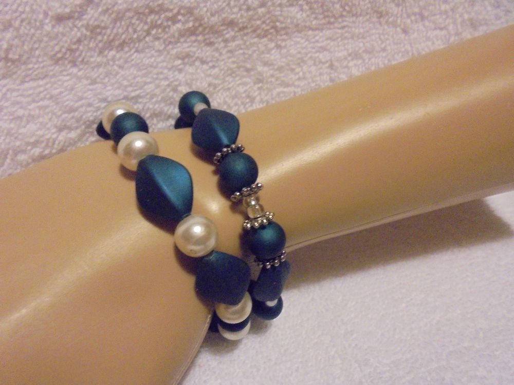 SET OF TWO AQUA/WHITE MATCHING  BEADED BRACELET- NICE BEADING...UNIQUE..STRETCH