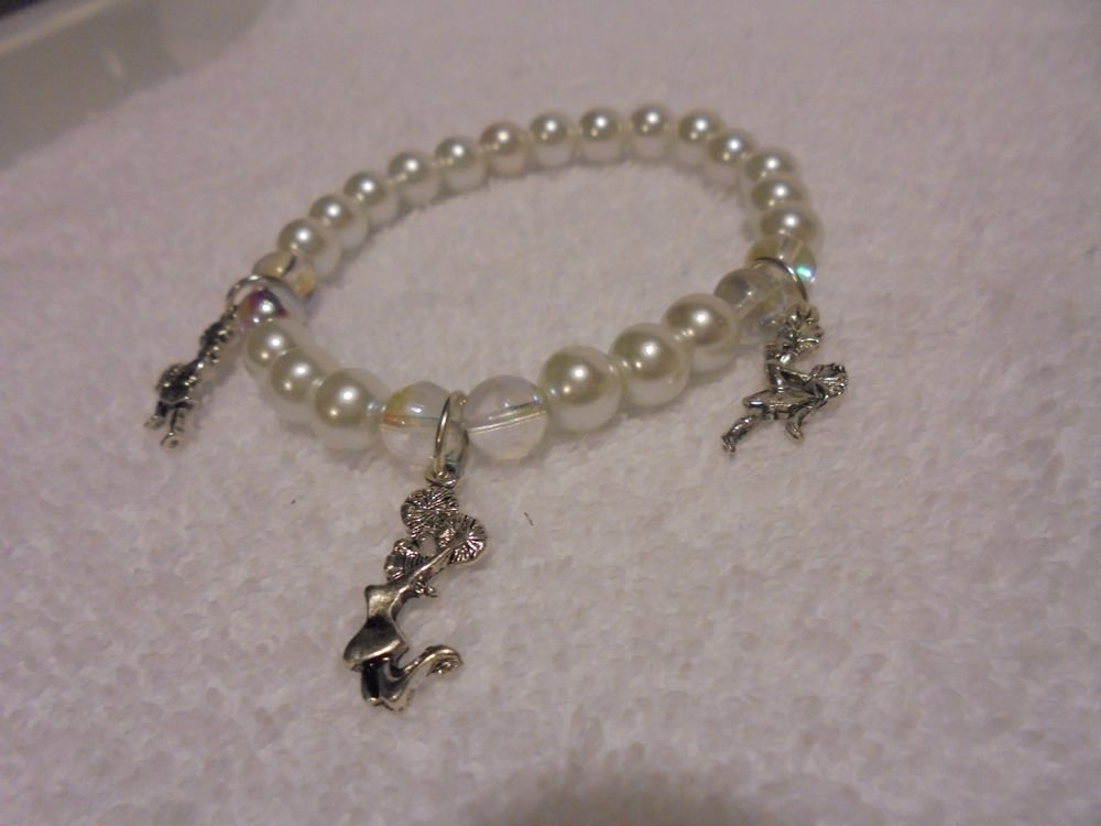 """THREE CHEERLEADER"" CHARMS ON A WHITE EXPANDABLE BEADED BRACELET....CUTE"