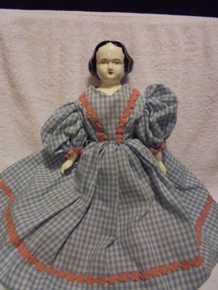 """ANTIQUE PORCELAIN PAINTED MOLDED BLACK HAIR DOLL ....APPROX 14"""" TALL...UNIQUE"""