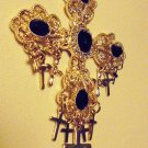 LARGE GOLDTONE/RHINESTONE/FLIIGREE CROSS...6 OTHER CROSSES HANGING FROM IT..