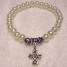 COMFORT CROSS LT CREAM PEARL BRACELET WITH  CHARM...EXPANDABLE....FITS ANY WRIST