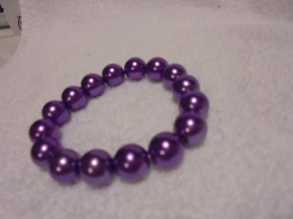 14 MM PURPLE BEADED  BRACELET....EXPANDABLE....GREAT ACCENT