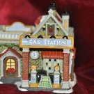 "Christmas Village Carole Town Collection Crawford's Garage, Gas Station 8"" Tall"