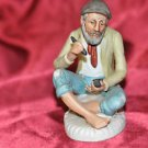 Old Man Smoking Pipe Sitting on a Floor Reading Packing Pipe (RARE) Unmarked