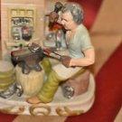 Ceramic Horse Shoe Maker Figurine Burt Reynold look alike 7''Tall Mixed Material