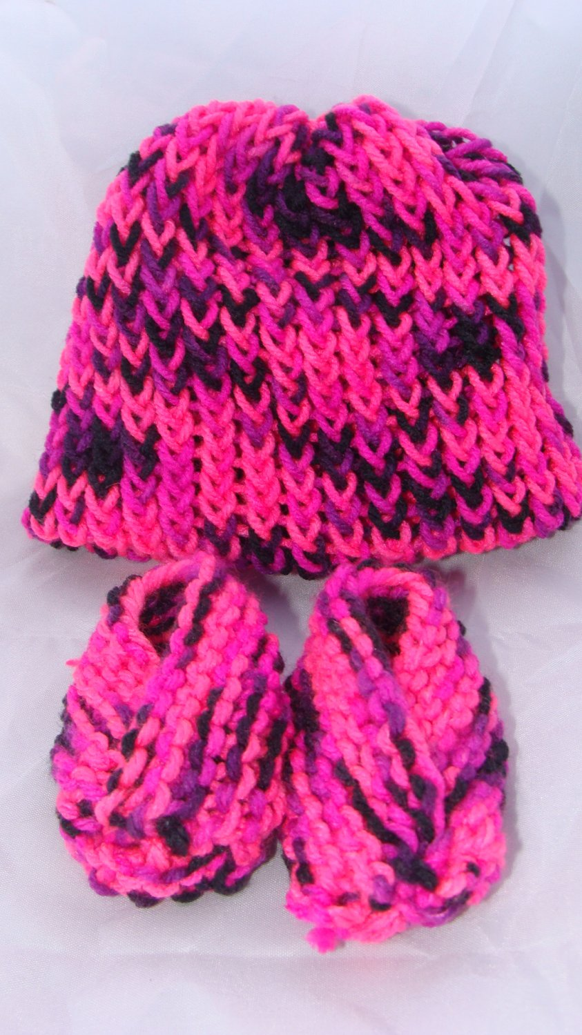 Pink baby booties and hat set