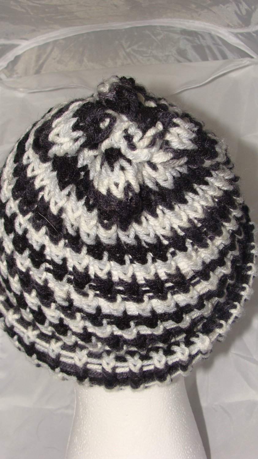 Adult grey, black and white hat