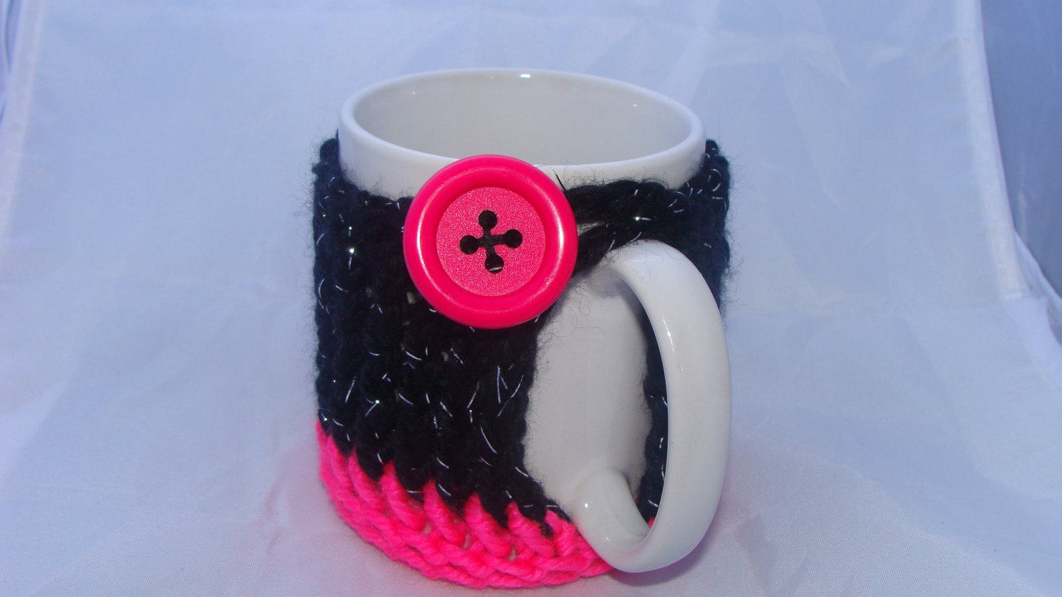 Black and pink mug koozie