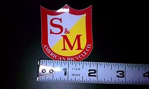S&M Shield Sticker Red Yellow White 1 7/8 W x 2 1/4 Tall Gloss First Class