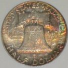 1958 D Rainbow Toned Obverse & Reverse MS 64 NGC Certified Franklin Half Dollar