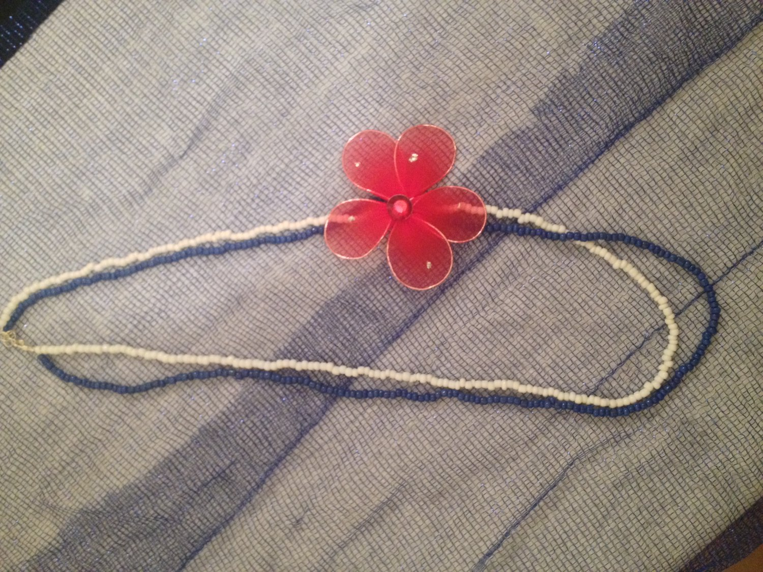 White and Blue Beaded Necklace with Red Flower