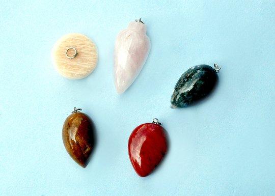 Set of five unique and antique Stone pendents