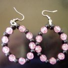 pink and black cirlced earrings