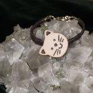 Brown Hemp woven on Hemp with a Tan Kitty Button w/Metal Clasp