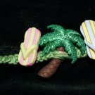 Green Handmade Hemp Bracelet with 2 sandals 1 Palm Tree and a Metal Closure