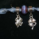 Blue Handcrafted Bracelet with 1 Ceramic Blue Bead and 2, 4 Leaf Clover Charms and Metal Closure