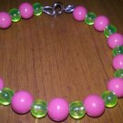 pink and green beaded bracelet with clasp