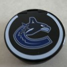 Hockey puck-shaped calculator VANCOUVER CANUCKS logo