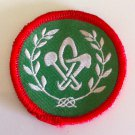 Morocco Scout badge with the Fleur de Lis surrounded by olive leafs of peace