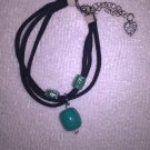 THREE STRAND TURQUOISE AND BLACK CHARM BRACELET