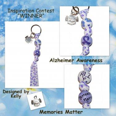 """Handpainted """"Memories Matter"""" Alzheimer Awareness Forget Me Not Keychain"""