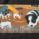 "SINGAPORE Phonecard ""Puppy Power"" NO VALUE - USED"