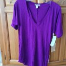 Women's purple v neck top by Quiksilver size extra small with side snaps ^