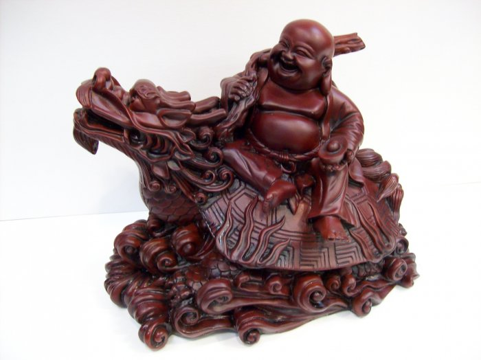 Laughing Buddha on Dragon