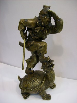 Bronze Monkey King on Top of Turtle
