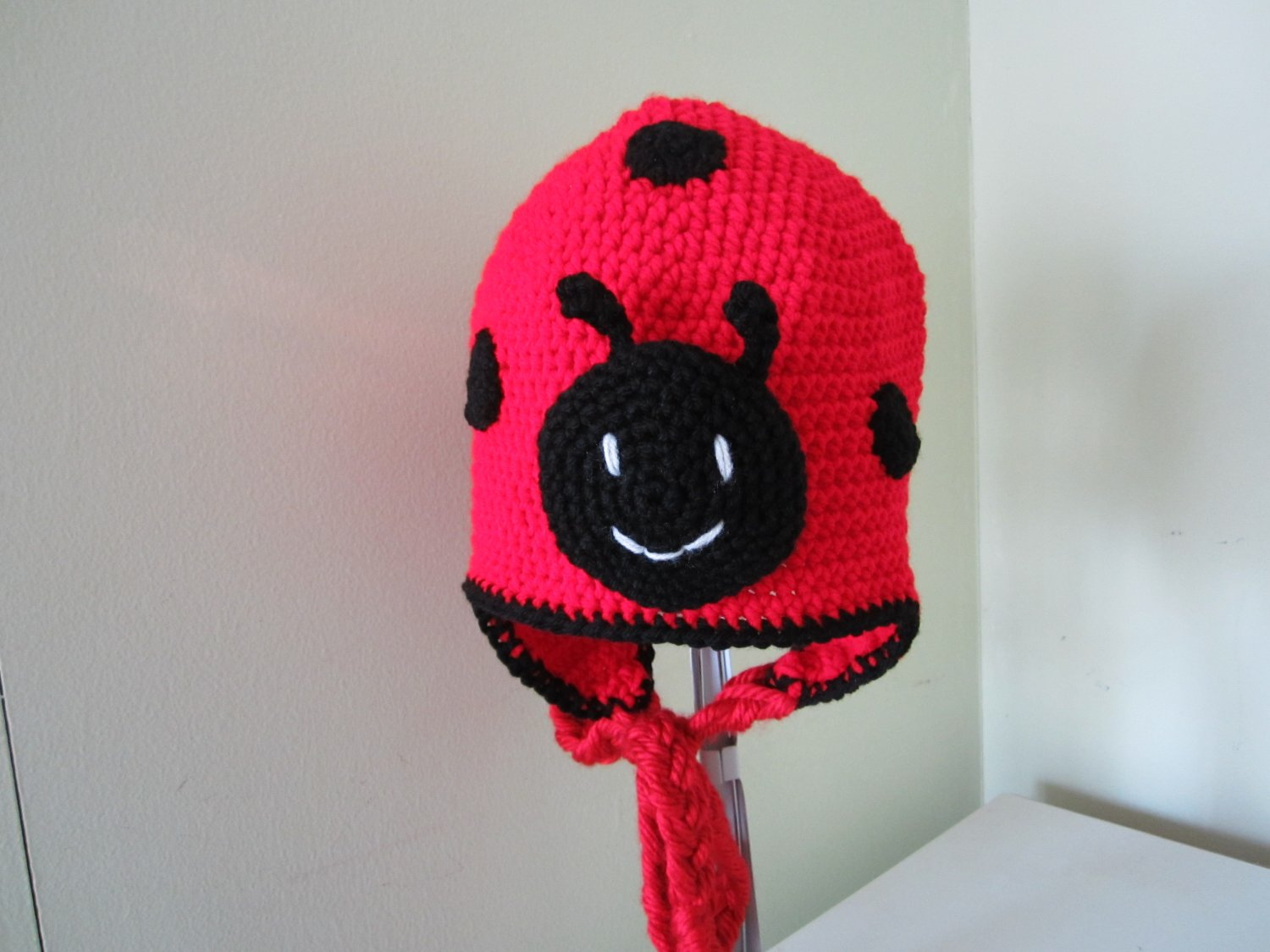 Crochet lady bug earflap hat