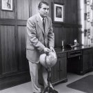 DR. WERNHER VON BRAUN POINTS TO SPOT ON A GLOBE IN HIS OFFICE - 8X10 PHOTO (EP-244)