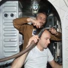 ASTRONAUT ALAN BEAN GETS A HAIRCUT DURING SKYLAB 3 - 8X10 NASA PHOTO (AA-088)