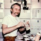 ASTRONAUT OWEN GARRIOTT ENJOYS A MEAL DURING SKYLAB 3 - 8X10 NASA PHOTO (AA-089)