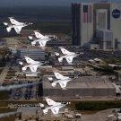 USAF THUNDERBIRD F-16s FLY IN FORMATION PAST THE NASA VAB - 8X10 PHOTO (ZZ-103)
