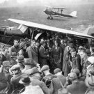 AMELIA EARHART RECEIVES CONGRATULATIONS AFTER SOLO FLIGHT - 8X10 PHOTO (AA-800)