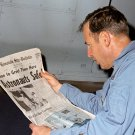 JIM LOVELL READS NEWSPAPER AFTER APOLLO 13 SPLASHDOWN - 8X10 NASA PHOTO (EP-647)